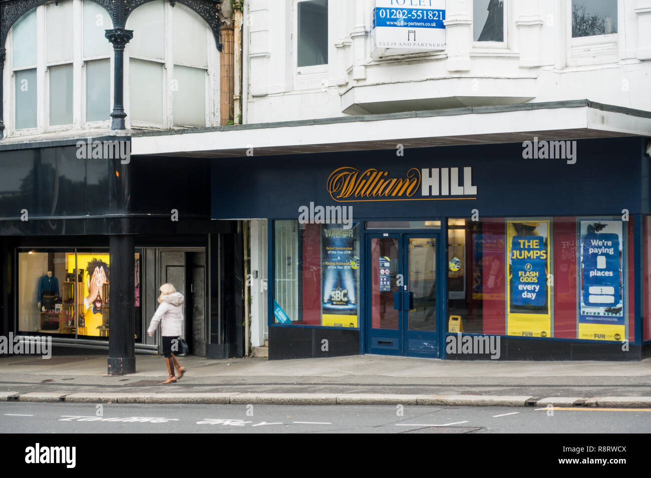 A William Hill betting shop, bookmakers, bookies on a UK high street, Bournemouth, United Kingdom - Stock Image