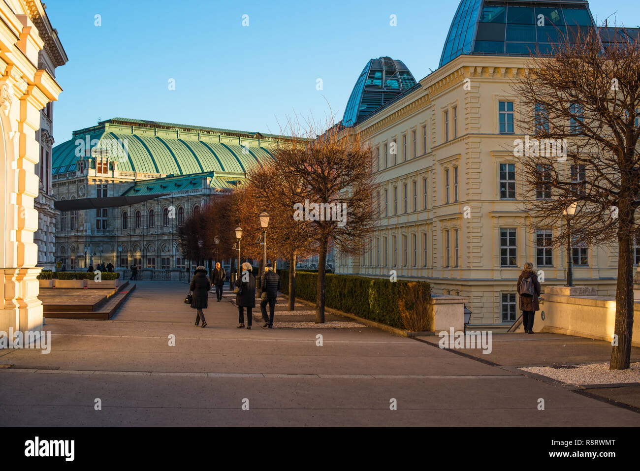 Street scene in the Innere Stadt (First District) of Vienna with the Alberina museum to the left and Opera house to the rear, Austria. - Stock Image