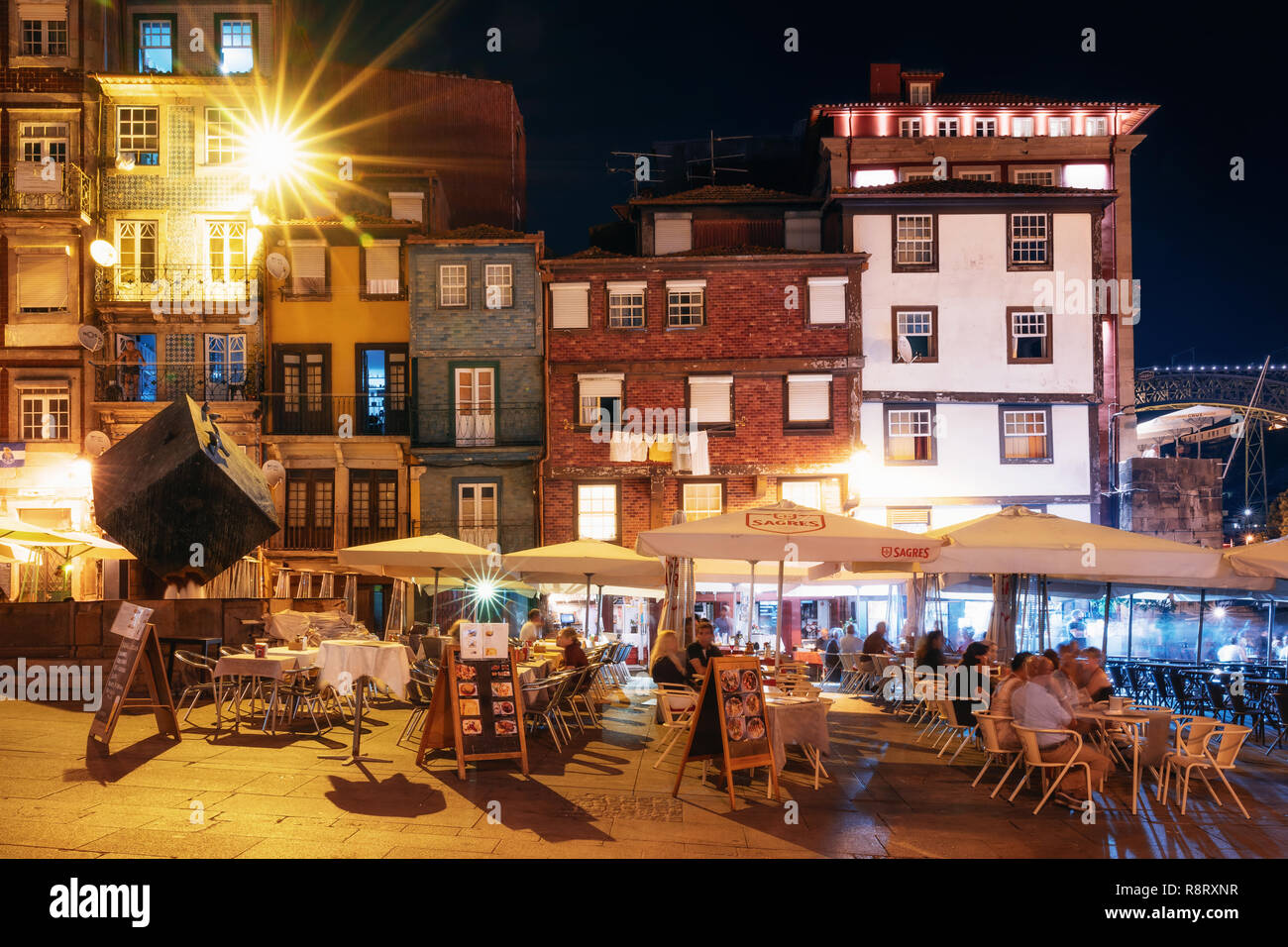 Porto, Portugal - September 27, 2018: Porto, Nightlife on the crowded promenade of the Douro River with cafes and restaurants in Porto - Stock Image