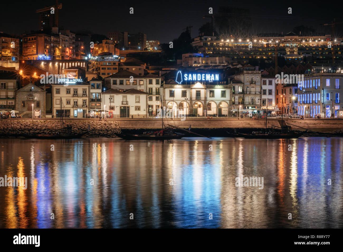 Vila Nova de Gaia, Porto, Lisbon - September 27, 2018: Panoramic view of Douro river embankment and Vila Nova de Gaia with House of Sandeman from the  - Stock Image