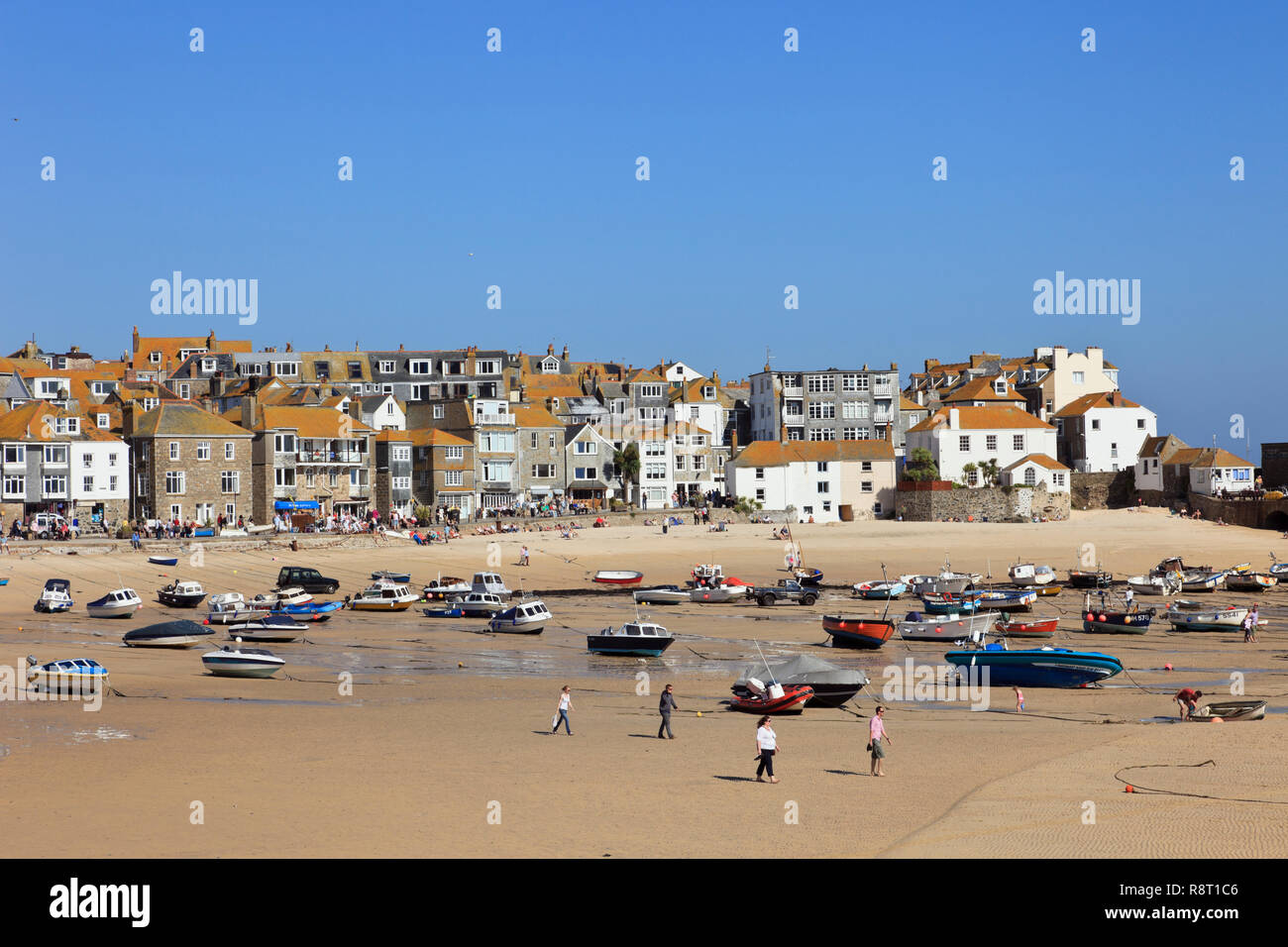 View of moored boats in the sandy harbour at low tide. St Ives, Cornwall, England, UK, Great Britain Stock Photo