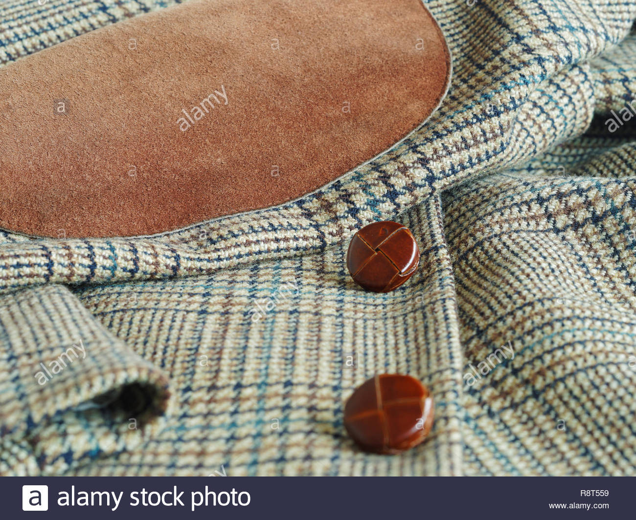 Close Up Of Men S Tweed Fabric Jacket With Leather Elbow Patches And