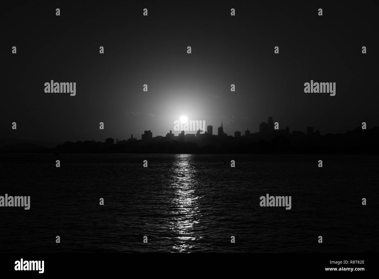 Black and white photograph of the sunrise over downtown San Francisco - Stock Image