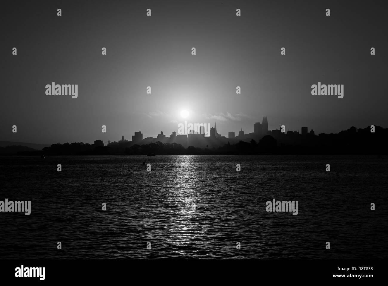 Black and white of the sunrise sun rising over downtown San Francisco - Stock Image