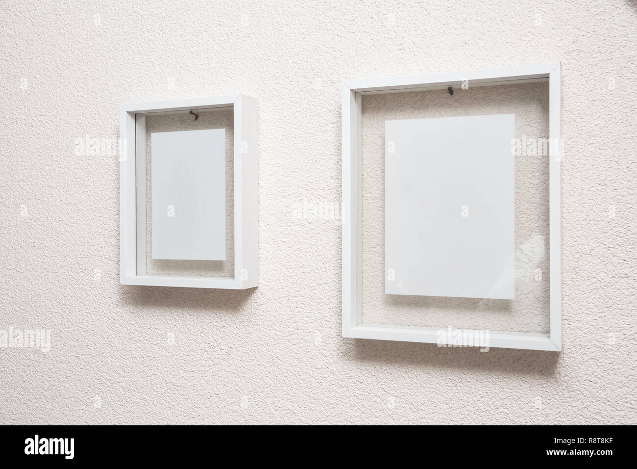 Two blank frame on white wall clean modern design - Stock Image