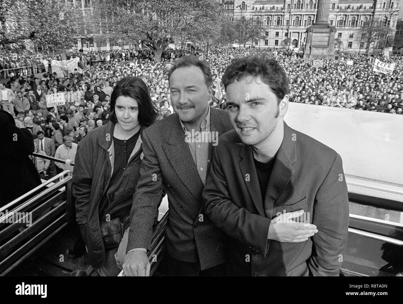 In 1992, George Square in Glasgow was packed with supporters, under the Scotland United banner for a free and independent Scotland. Three of the speakers were a young Nicola Strugeon. A rising star of the Scottish National Party who became the SNP leader and First Minister of Scotland. George Galloway, the maverick politician and MP. Pat Kane who was the founding member, and signer, of the Scottish pop group; Hue and Cry and is now a well respected journalist, writer and columnist. Alan Wylie/ALAMY © - Stock Image