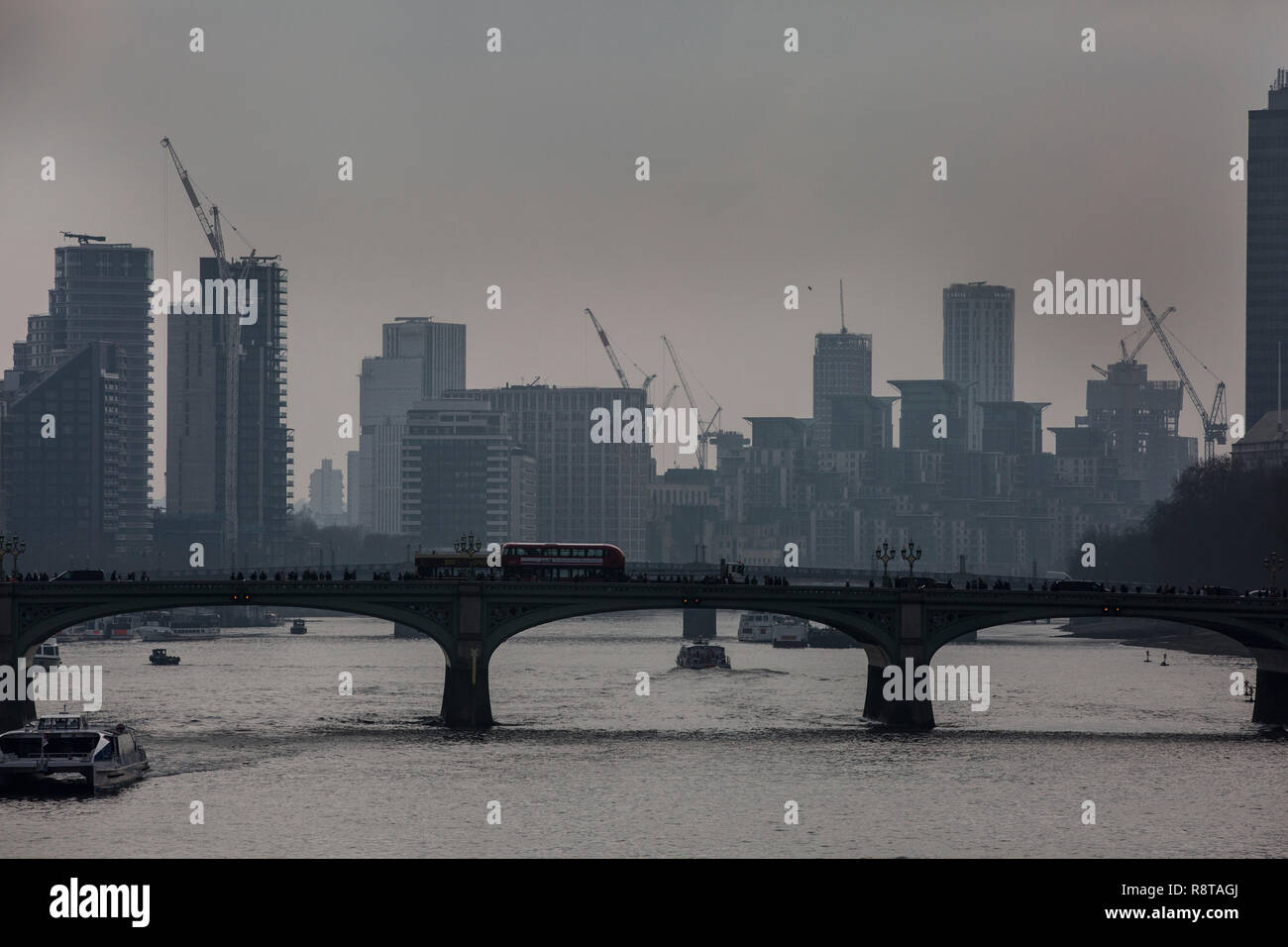 Pollution sits on the horizon over Westminster Bridge, central London, England, UK - Stock Image