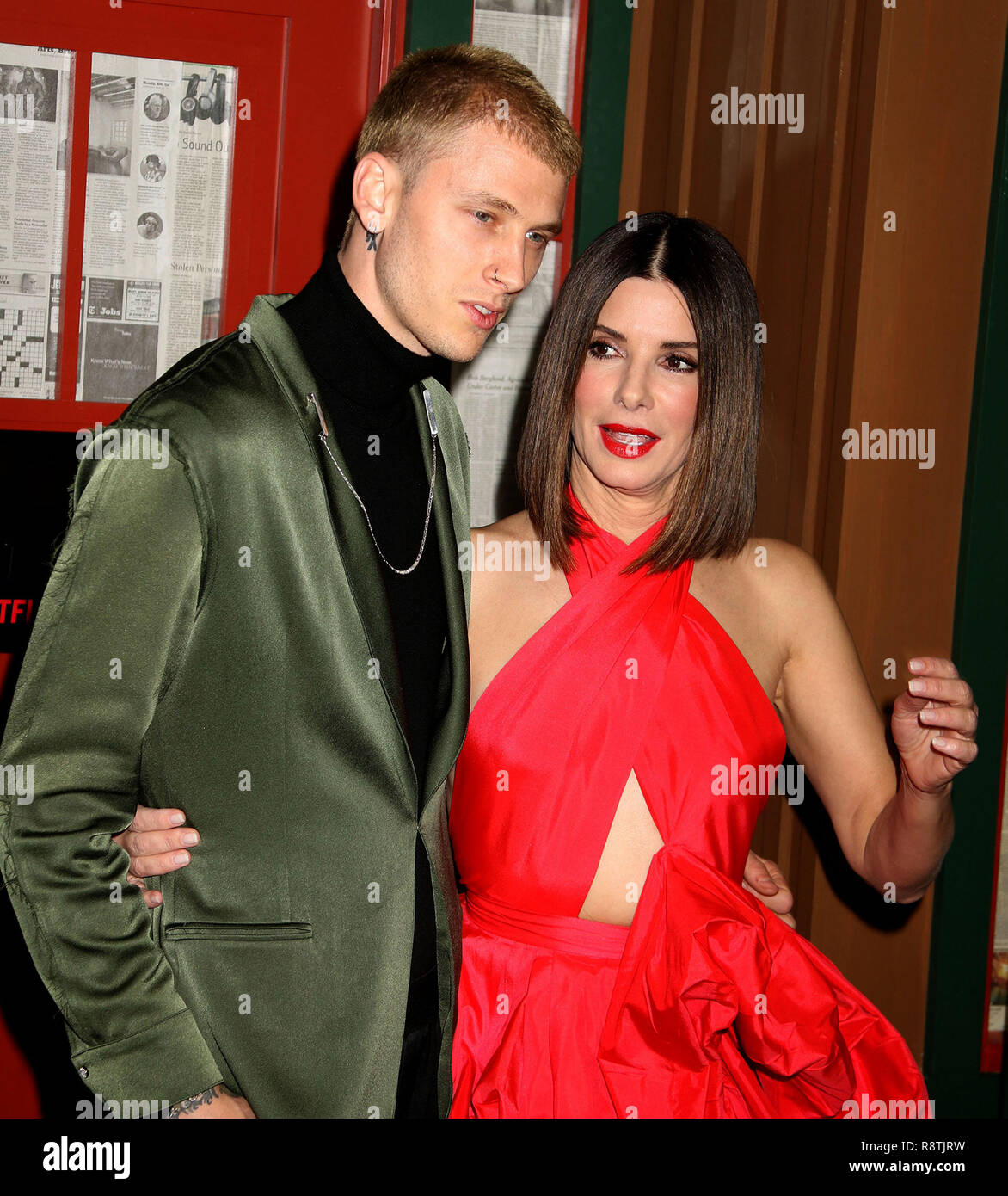 New York City, New York, USA. 17th Dec, 2018. Actor COLSON BAKER aka MACHINE GUN KELLY and actress SANDRA BULLOCK attend the New York Special Screening of 'Bird Box' held at Alice Tully Hall at Lincoln Center. Credit: Nancy Kaszerman/ZUMA Wire/Alamy Live News - Stock Image