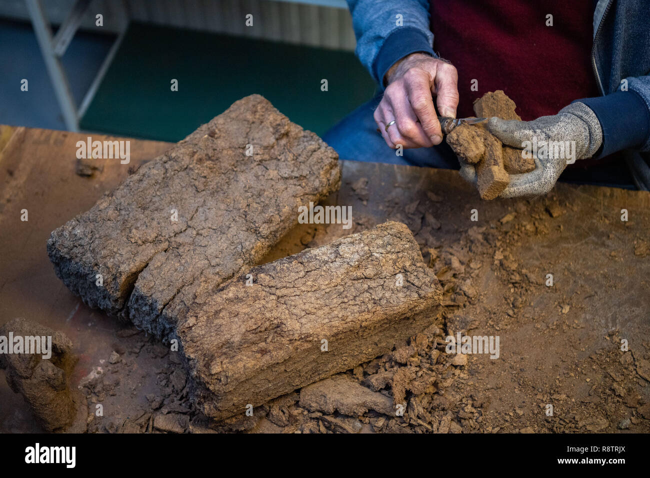Saterland, Germany. 22nd Nov, 2018. Karl-Heinz Brinkmann carves Christmas figures from peat in his home workshop. The 64 year old Saterland artist works with many materials. But the dried white peat is special: it is 2000 years old. Credit: Mohssen Assanimoghaddam/dpa/Alamy Live News Stock Photo