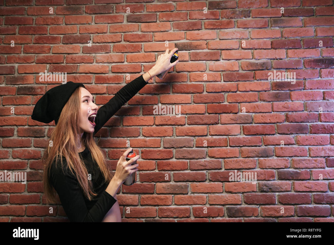 Image Of Beautiful Hip Hop Woman 20s Drawing On Brick Wall With