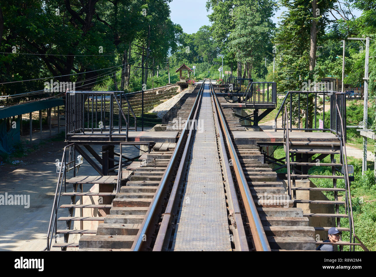 Rail tracks of the Siam-Burma Railway over River Kwai in Kanchanaburi, Thailand. The infamous bridge has become a tourist destination for the well-doc - Stock Image