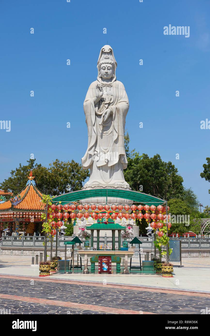 Very large statue of Buddhist goddess of mercy Guanyin, in Kuang Im Chapel, near River Kwai, in Kanchanaburi, Thailand. Stock Photo