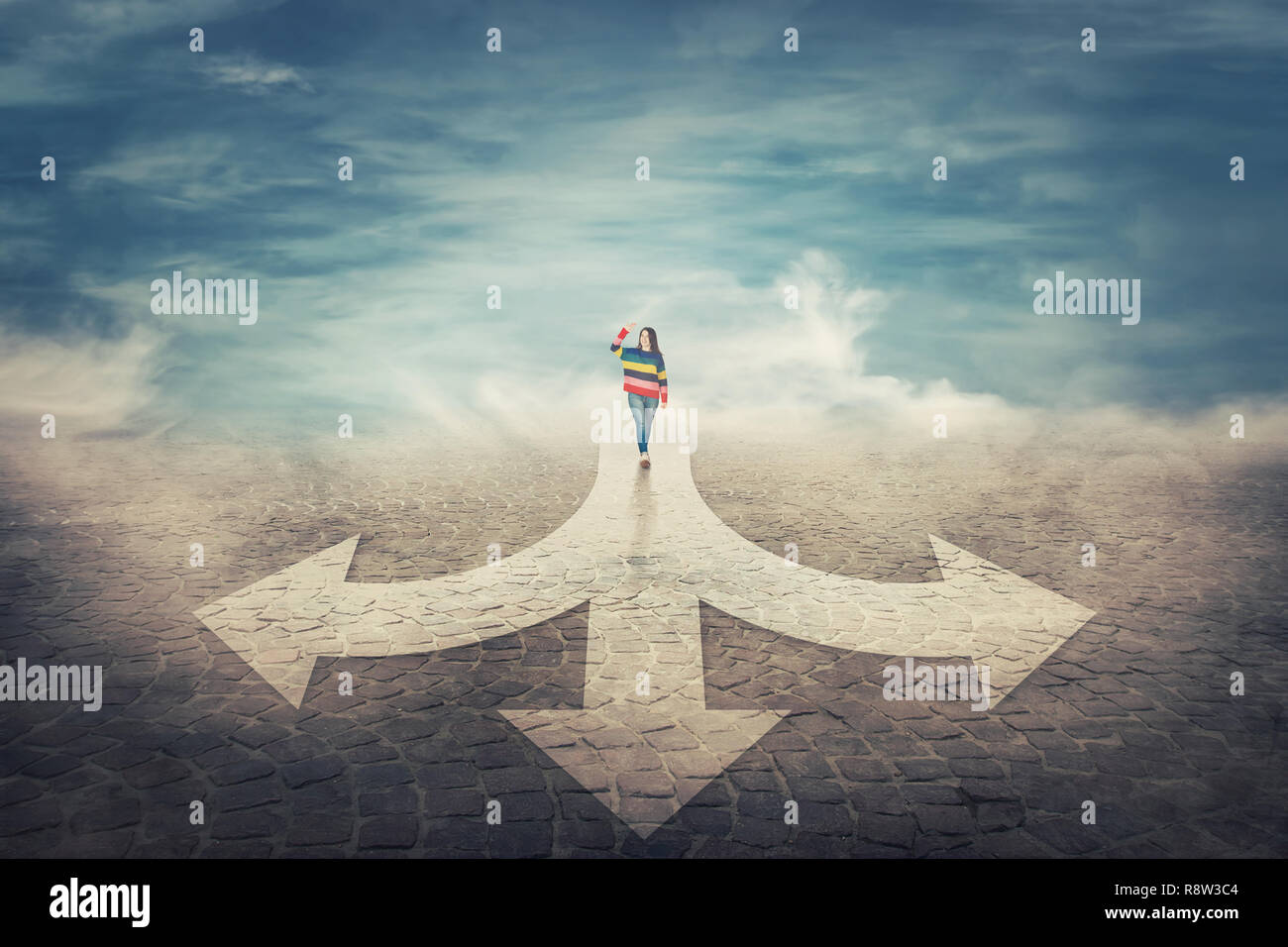 Surreal view as woman hand up walking in front of a crossroad splitted in three different ways as road arrows. Choosing the correct pathway between le - Stock Image