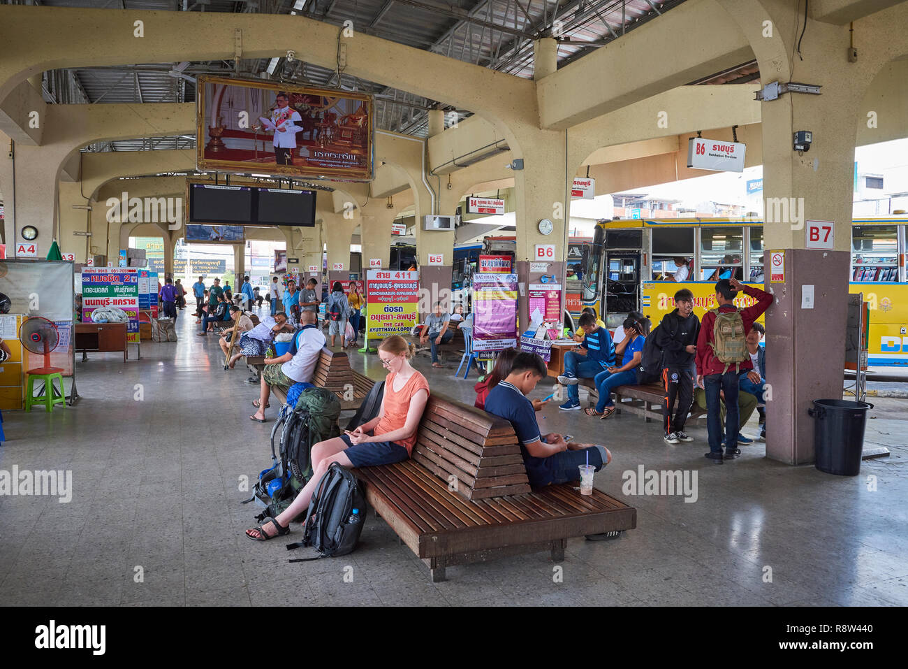 Passengers await in the departure area of  Kanchanaburi central bus terminal, in Thailand. Stock Photo