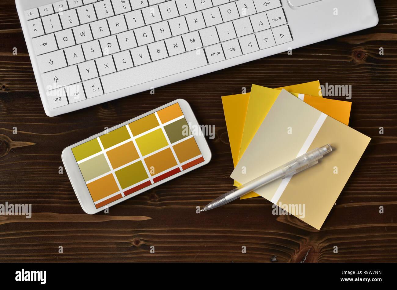 Color samples cmyk on black keyboard mobile - Stock Image