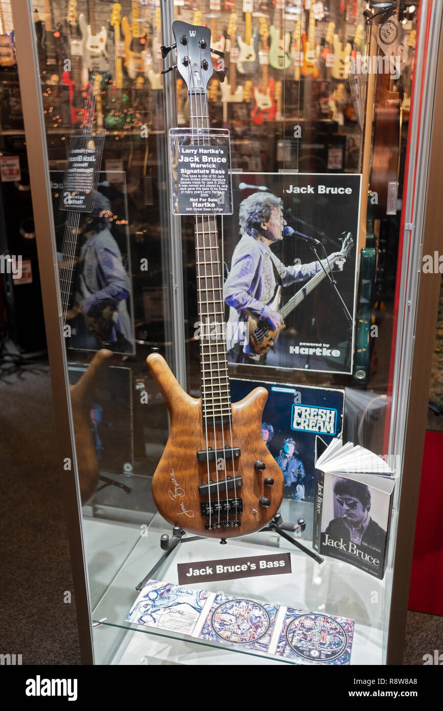 A signed Jack Bruce's Warwick bass guitar on display at Sam ash music store on West 34th Street in Manhattan, New York City. - Stock Image