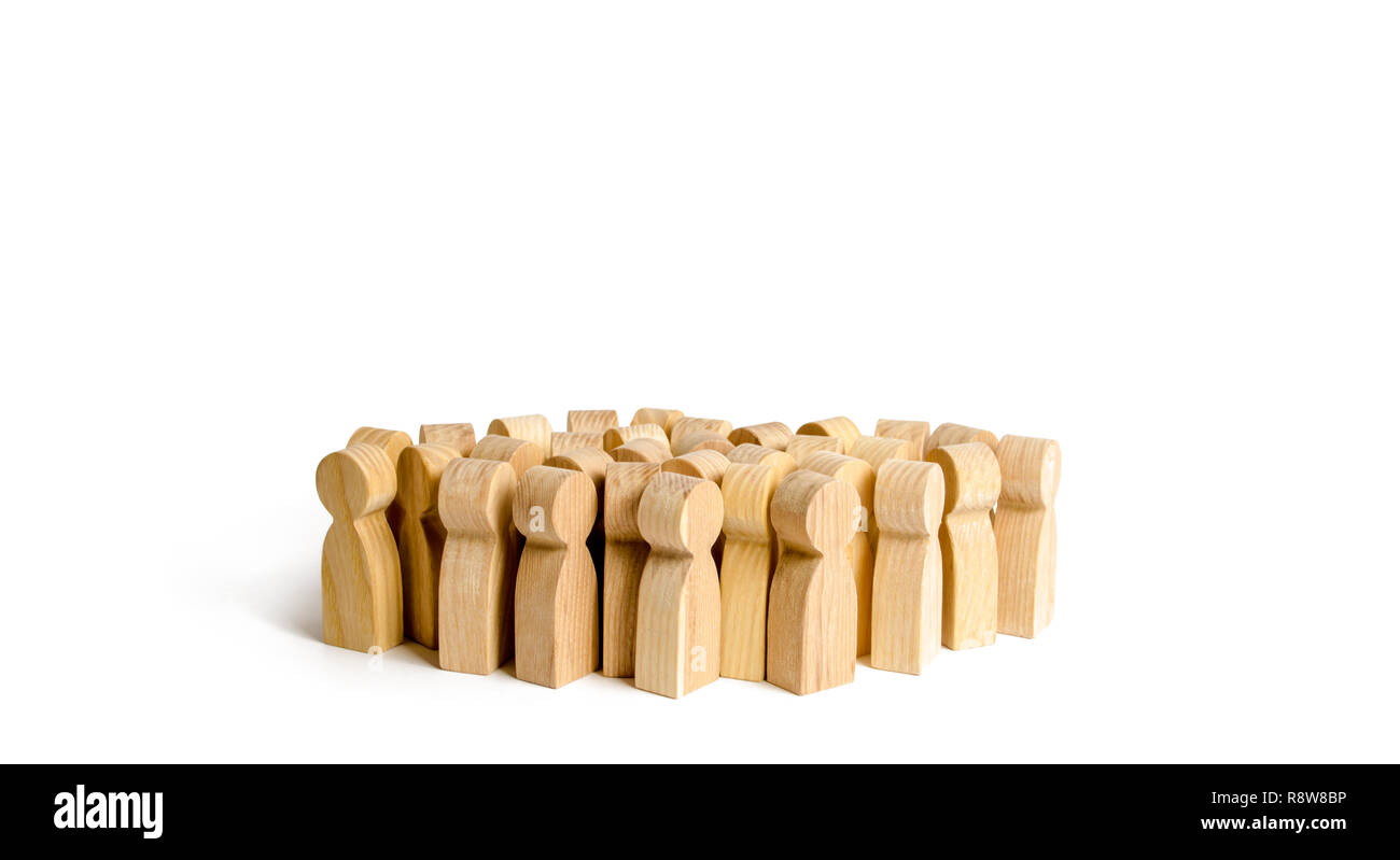 A crowd of people on a white background. Many wooden figures of people. The concept of gregarious feelings, the segmentation of consumers and customer - Stock Image
