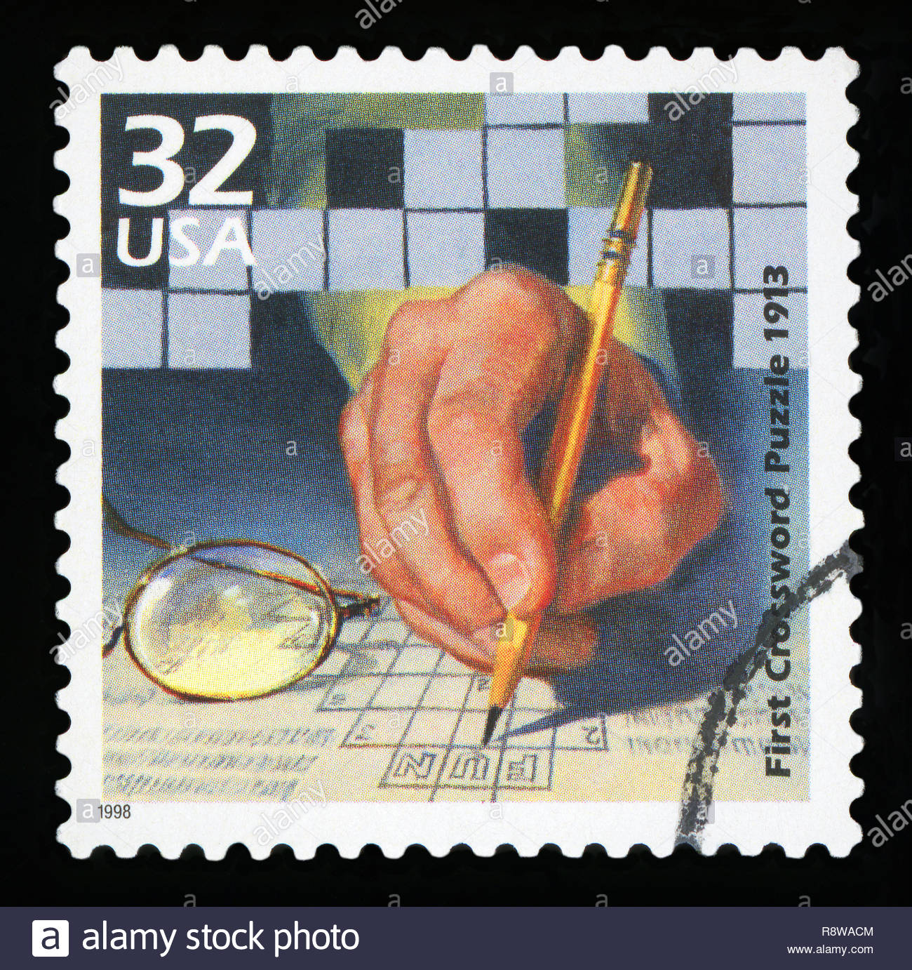 UNITED STATES OF AMERICA - CIRCA 1998: A stamp printed in USA shows First crossword puzzle published, 1913, series Celebrate the Century, 1910s, circa - Stock Image