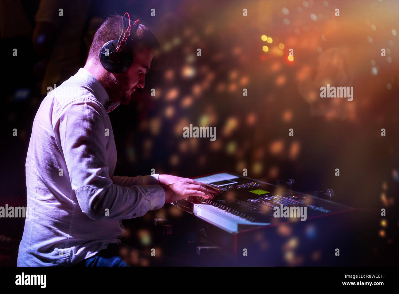 Artist playing on the keyboard synthesizer piano keys. - Stock Image