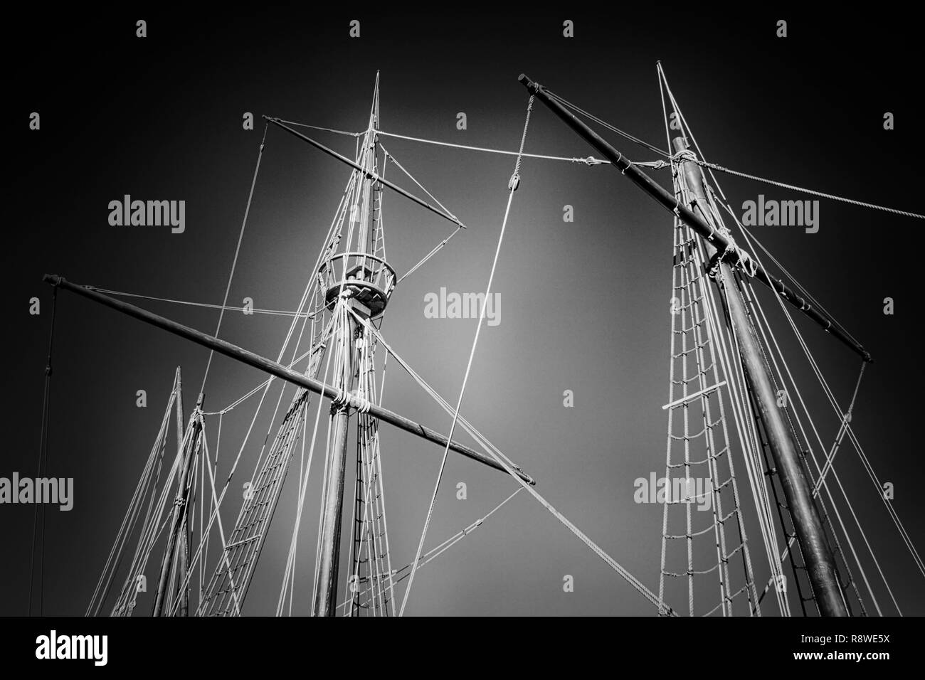 Masts and rigging of a portuguese caravel from the time of discovery. Used infrared filter. - Stock Image
