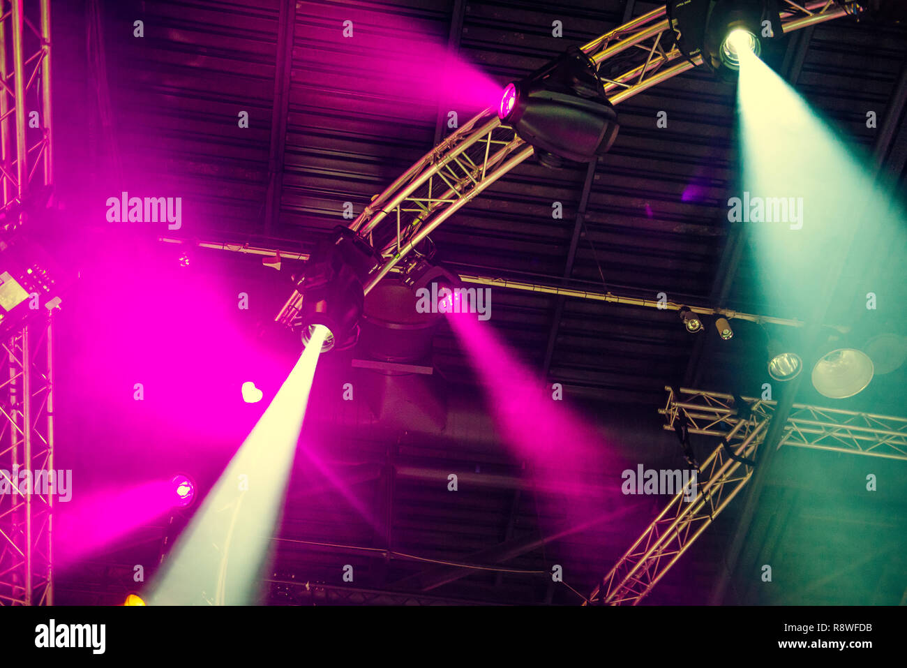 Stage lights on concert. Lighting equipment with multi-colored beams. Bottom view. Selective focus. Copy space - Stock Image