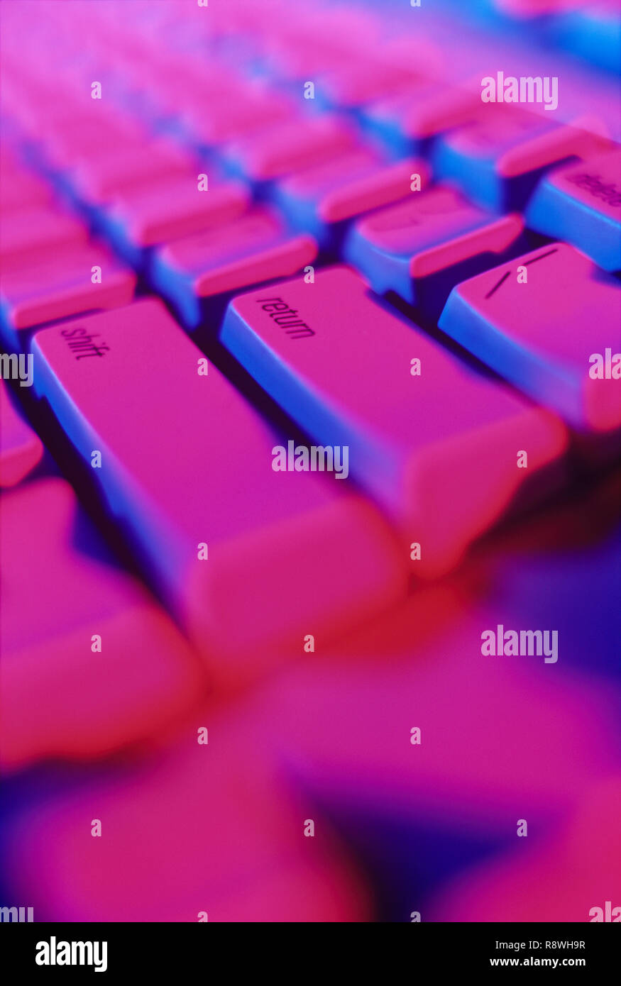 Colorful closeup of computer keyboard with the emphasize on the enter key - Stock Image