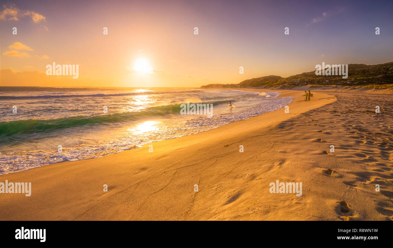 Sunset Surfers - Stock Image