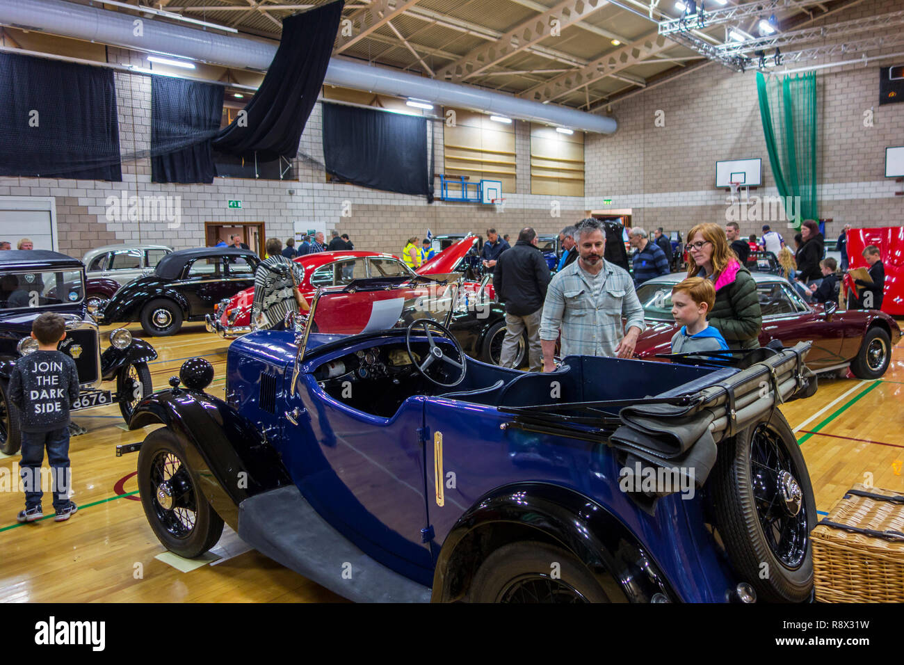 Visitors looking at vintage cars / oldtimers at the Shetland Classic Motor Show in Lerwick, Shetland Islands, UK - Stock Image