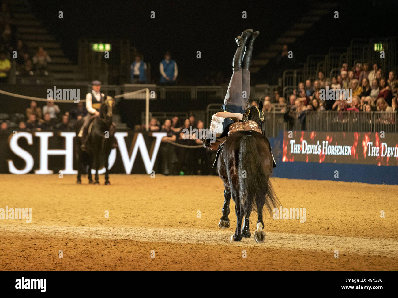 The Devil's Horsemen perform during day one of the London International Horse Show at London Olympia. - Stock Image