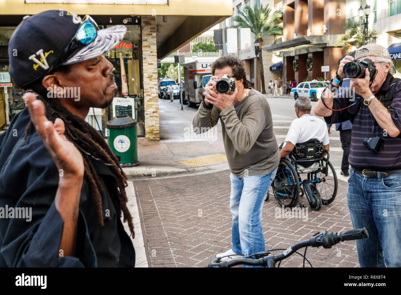 Miami Florida downtown Black man being photographed by street photographers - Stock Image