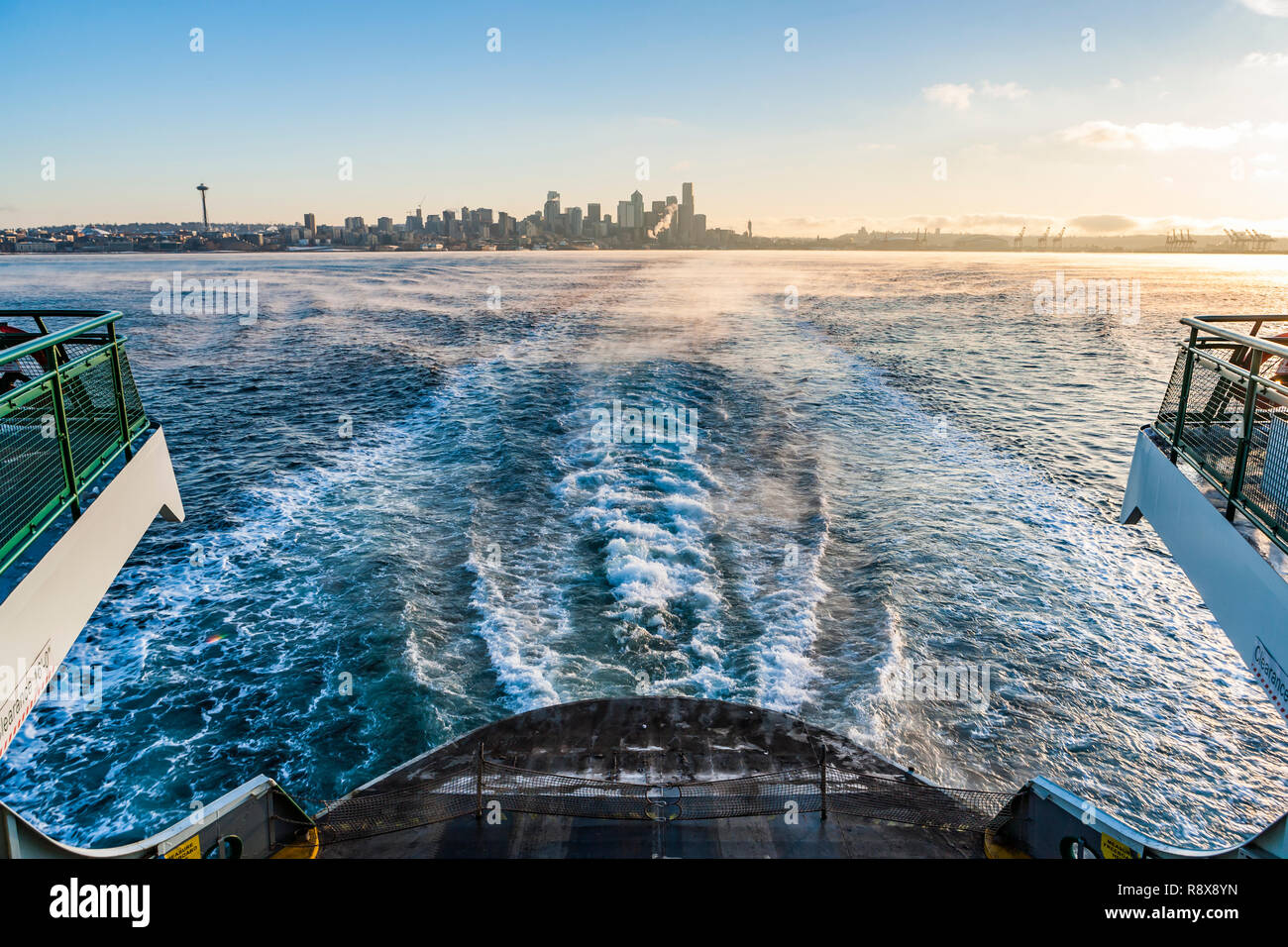 Looking back at Downtown Seattle, Washington, USA from a Washington State ferry on a cool clear Fall morning. - Stock Image