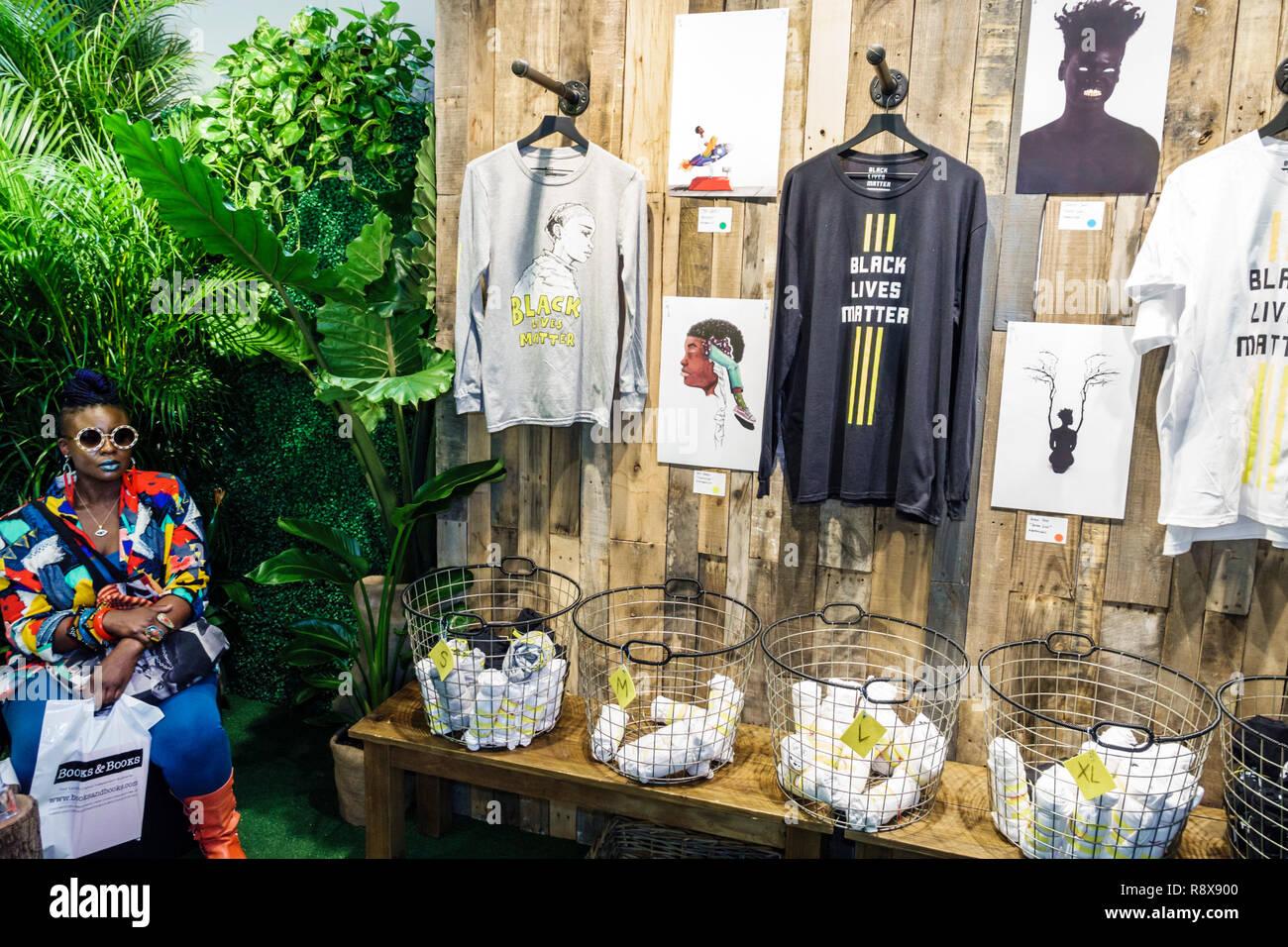 Miami Florida downtown Art Basel Prizm Art Fair inside interior Black Lives Matter pop-up store display sale shirts - Stock Image