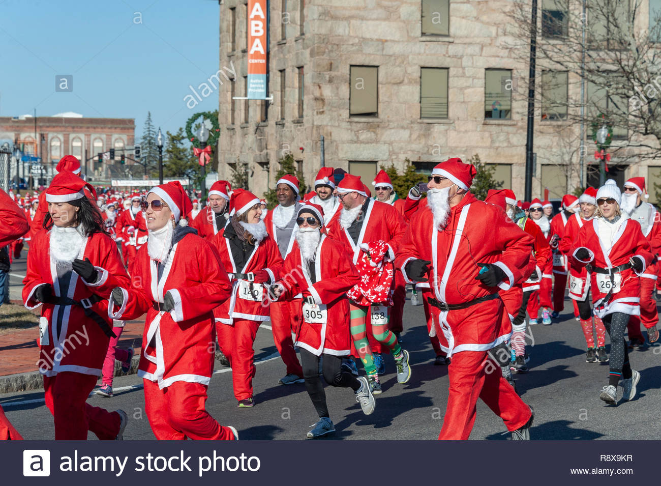 New Bedford, MA, USA - December 8, 2018: Santa with trim beard and aviator sunglasses perfect for sunny but chilly race at Santa Sightings 5K Fun Run - Stock Image