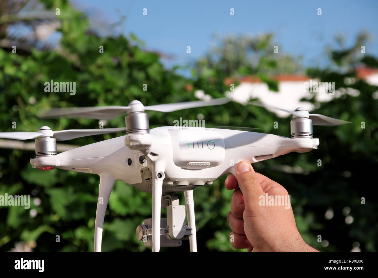 Man is holding a drone in hand and using of new technology