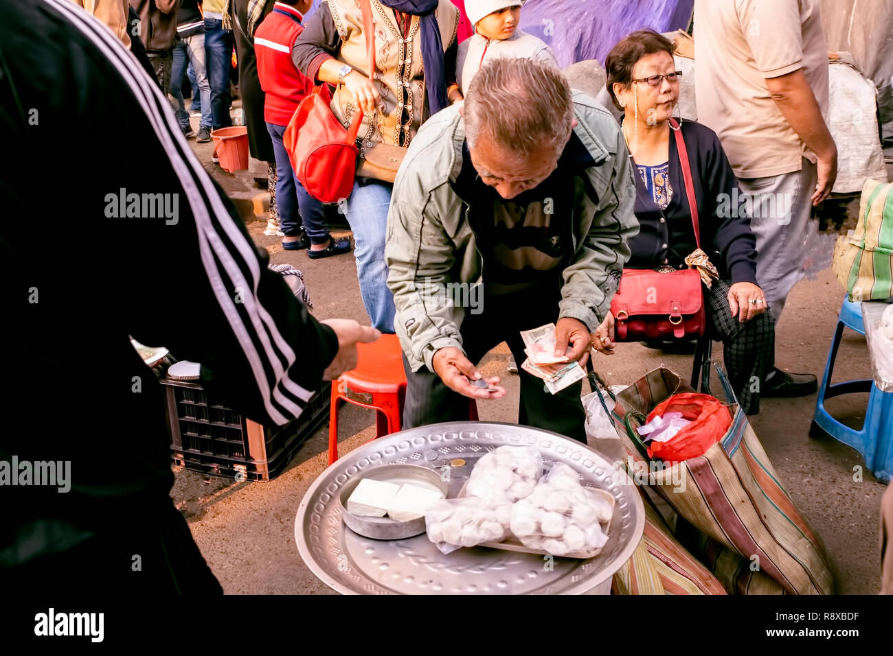 Sreet life,Chinese street food,hot dumplings,sellers,puchasers, Territy Bazar,Chinese,Indian,visit ,on,Sunday morning,India Exchange Place,Kolkata, In Stock Photo