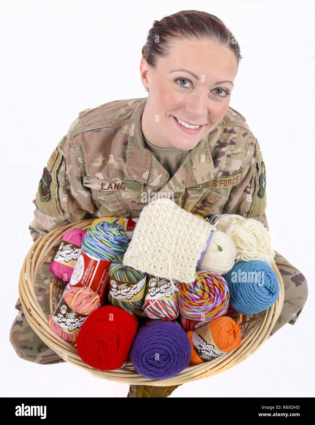 Tech. Sgt. Amber Lang assigned to the 171st Air Refueling Wing Maintenance Squadron near Pittsburgh poses for a photo Dec. 7, 2018. Lang volunteers at the Southwestern Veterans Center and teaches residents how to crochet. Stock Photo