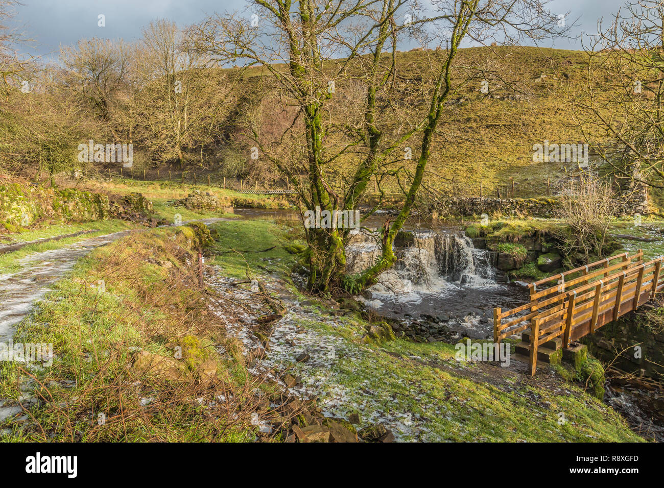 Waterfall and Footbridge, Ettersgill Beck, Teesdale in Winter Sunshine Stock Photo