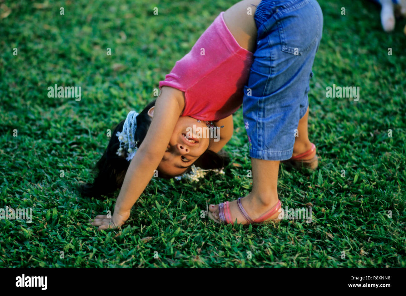 girl bend done and looking MR.NO.273 - Stock Image