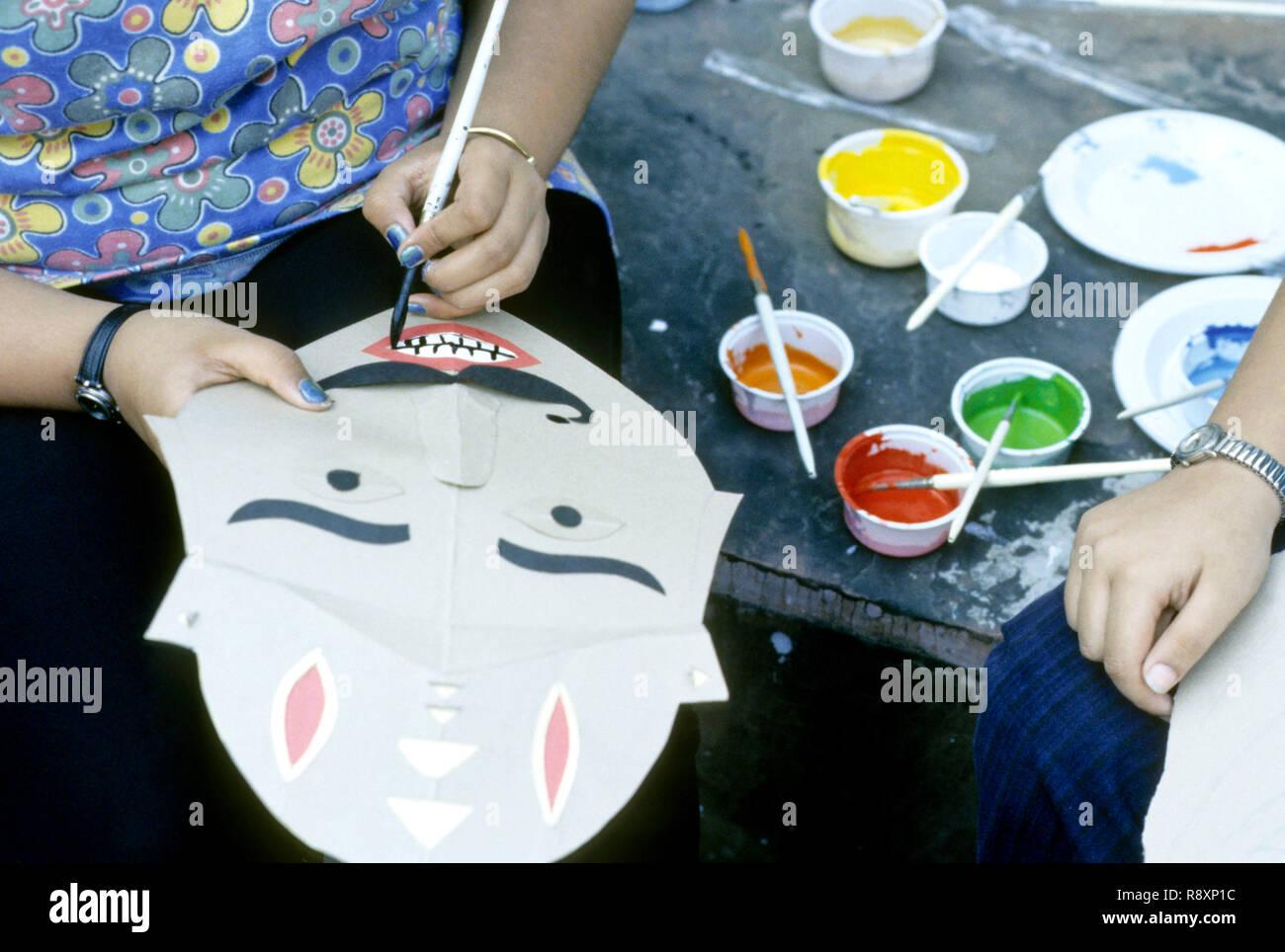 girl making ramayan story, workshop of children, mumbai bombay, maharashtra, india - Stock Image