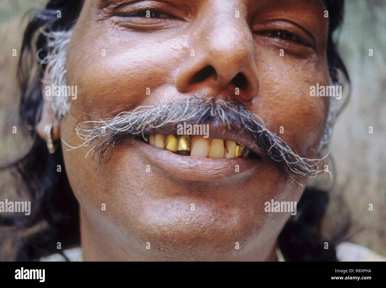 Indian man with gold teeth - Stock Image