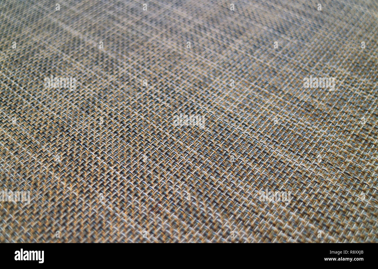 Closed up diagonal basket-weave pattern of a luncheon mat for background or banner - Stock Image