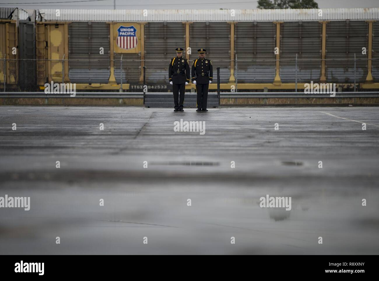 Two Union Pacific Police Honor Guardsmen standby as the funeral train, carrying the former President George H.W. Bush, heads to his final resting place after a departure ceremony at Union Pacific Westfield Auto Facility, Spring, Texas, Dec. 6, 2018. The funeral car was pulled by the 4141 locomotive and carried Bush's remains to College Station, Texas. Nearly 4,000 military and civilian personnel from across all branches of the U.S. armed forces, including Reserve and National Guard components, provided ceremonial support during the state funeral of George H.W. Bush, the 41st President of the U Stock Photo