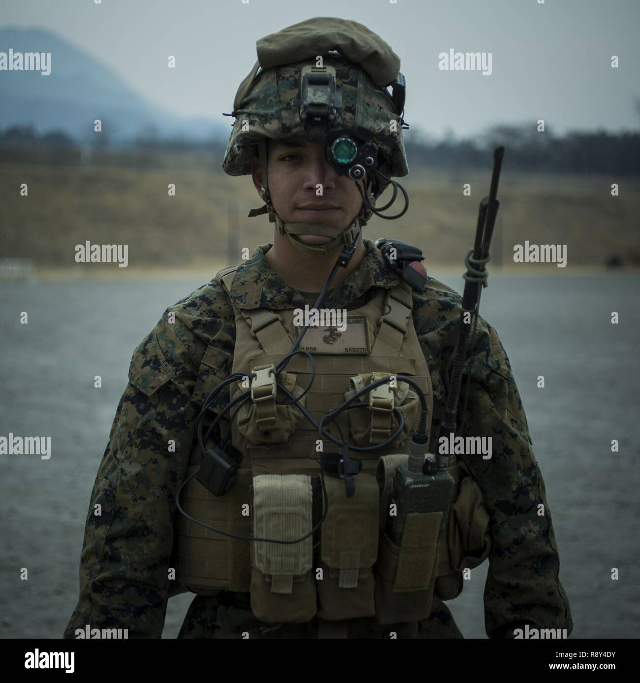 U.S. Marine Lance Cpl. Joshua Acevedo, a rifleman, prepares to demonstrate  the use of night vision goggles to Japanese Ground Self-Defense Force  Soldiers at Somagahara, Japan, March 6, 2017. Forest Light is