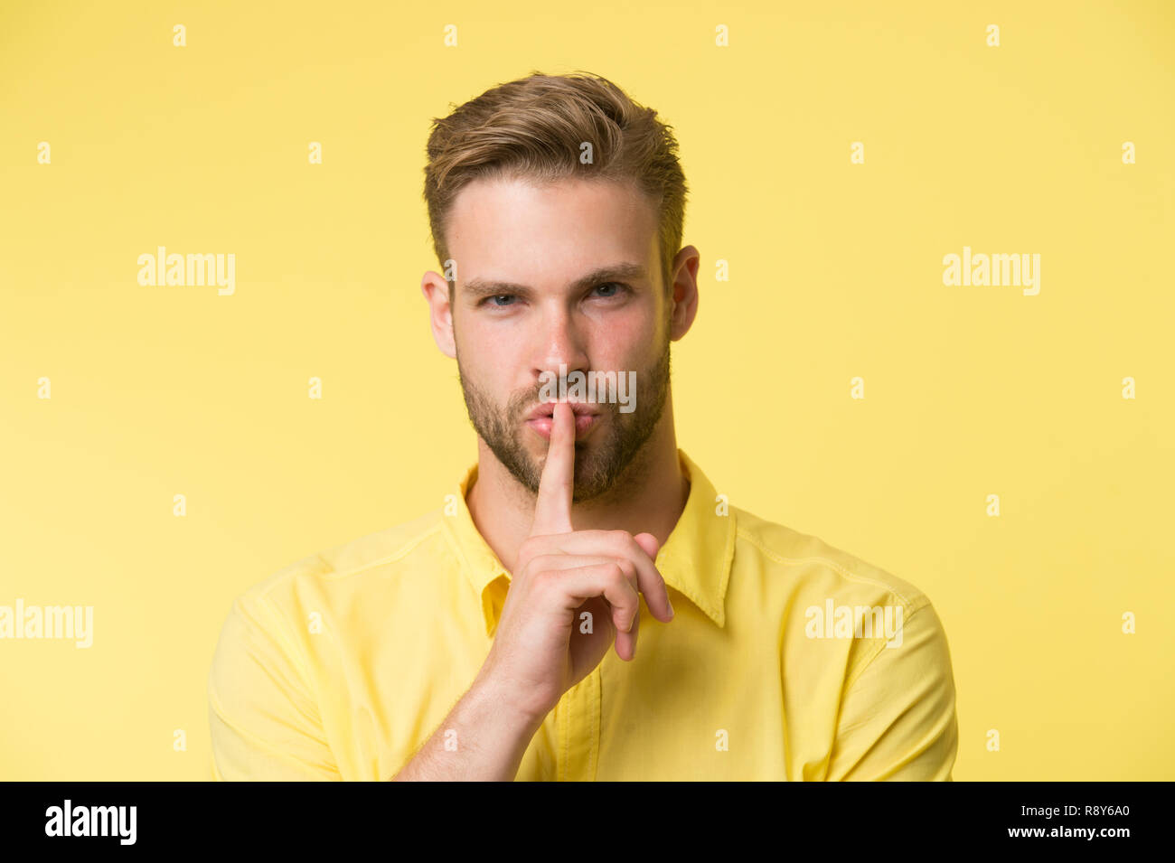 Can you keep secret. Handsome man keep index finger by his lips. Be silent. Secret story concept. Guy confident face just told his secret. Rumor legend and myth. Confidential information and secret. Stock Photo