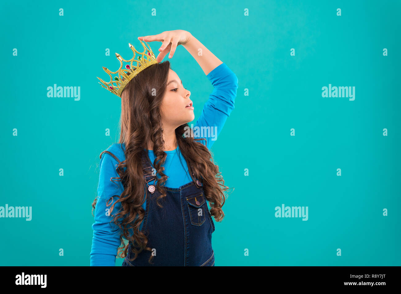 Feels like queen kid wear golden crown symbol of princess every girl dreaming to become princess lady little princess girl cute baby wear crown while