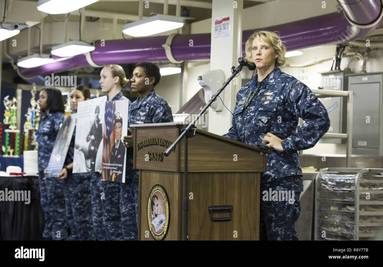 NEWPORT NEWS, Va. (March 3, 2017) Capt. Amy Bauernschmidt, executive officer of the Nimitz-class aircraft carrier USS Abraham Lincoln (CVN 72) speaks during the Women's History Month observance on the ship's mess deck. The event honored trailblazing Navy women such as Rear Adm. Grace Hopper, Capt. Sarah Joyner, and Chief Yeoman Loretta Walsh. - Stock Image