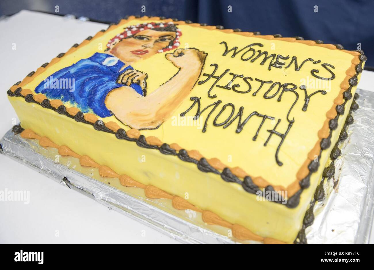 "NEWPORT NEWS, Va. (March 3, 2017) A special ""Rosie the Riveter"" cake was created by the bakery shop aboard USS Abraham Lincoln (CVN 72) for the command's Women's History Month observance on the ship's mess deck. The event honored trailblazing Navy women such as Rear Adm. Grace Hopper, Capt. Sarah Joyner, and Chief Yeoman Loretta Walsh. - Stock Image"