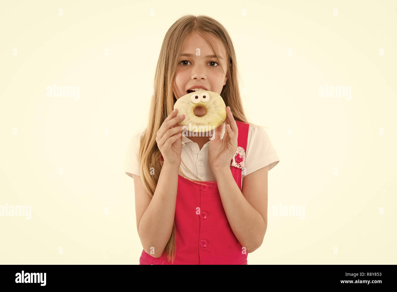 Little girl eat donut isolated on white. Child with glazed ring doughnut. Kid with junk food. Food for snack and dessert. dieting and fitness concept. Childhood and childcare, copy space. - Stock Image