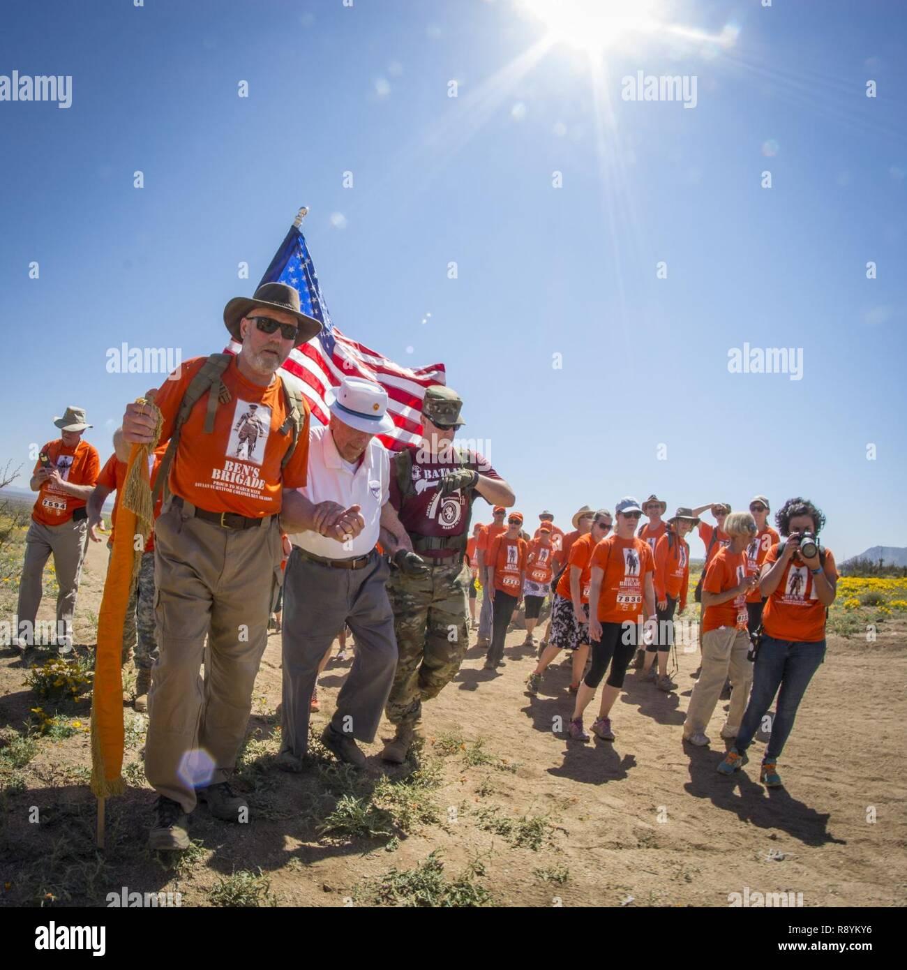 Ben Skardon 99 A Survivor Of The Bataan Death March Walks Under Blazing New Mexico Sun Aided By Members His Loyal Support Team Bens Brigade
