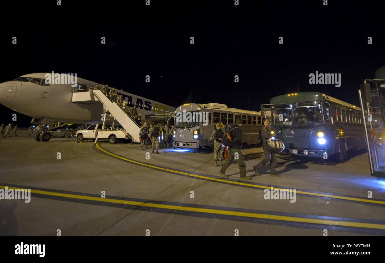 More than 200 Airmen from the 90th Fighter Squadron returned to Joint Base Elmendorf-Richardson, Alaska, March 18, 2017 after participating in a bilateral exercise and training mission with the Royal Australian Air Force Base Tindal, Northern Territory, Australia. - Stock Image
